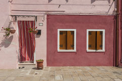 Red colorful house of Burano Island with laundry, Venice, Italy Stock Images