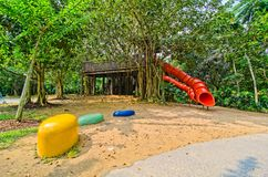 Red colorful slide treehouse garden play area Stock Photography