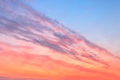 Beauty colorfully northern sunset sky. Red colorfully sunset with blue areas and purple feather clouds Stock Photos