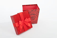 Red colour christmas parcel and present on white background Stock Images
