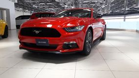 Red colour ford mustang car at showroom Stock Photography