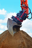 Red coloured construction digger Royalty Free Stock Images