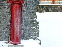 Red Column Sculpture on the Snow Royalty Free Stock Photo