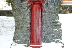 Red Column Sculpture on the Snow Royalty Free Stock Photos