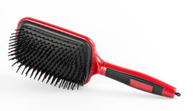 Red comb the hair on a white background Royalty Free Stock Images