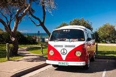Red Combi Van. A red and white combi van parked at the beach Stock Images