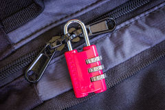 Red combination padlock on luggage Stock Photography