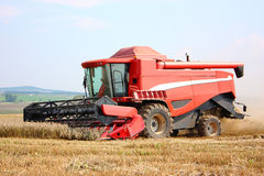 A red combine harvester Royalty Free Stock Photos