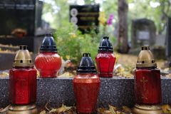 Commemorative candles in the cemetery royalty free stock photography