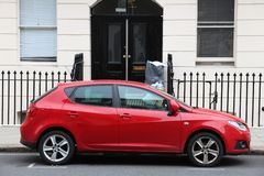 Red compact car. LONDON, UK - JULY 9, 2016: Seat Ibiza compact car parked in London, UK. Seat is part of Volkswagen Group, 3rd largest car maker with 9.7 million Royalty Free Stock Image
