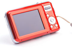 Red compact zoom digital camera over white Stock Images