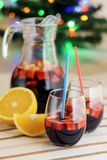 Red compote poured into a jug and two glasses. And a slice of orange stock image