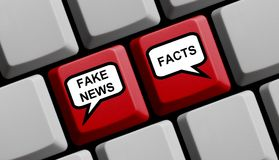 Computer Keyboard with balloons Fake or News Facts. Red Computer Keyboard with balloons showing Fake News or Facts Stock Images