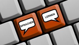 Computer Keyboard with balloons Learn Languages german. Red Computer Keyboard with balloons showing Learn Languages online in german language Stock Photo