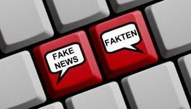 Computer Keyboard Fake News Facts german. Red Computer Keyboard showing Fake News or Facts in german language Stock Photo