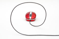 Red computer mouse with cable Royalty Free Stock Photos