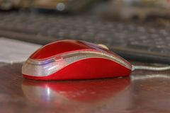 Red computer mouse close-up. Red computer mouse close up office education royalty free stock photos