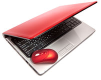 Red computer mouse and red notebook.Close up Royalty Free Stock Photo