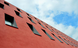 Red Concrete Building Under Cloudy Sky during Daytime Royalty Free Stock Photos