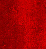 Red Concrete wall. Wall concrete with grains and textures painted in dark red stock photo