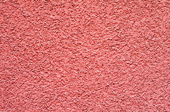 Red concrete wall, surface texture plaster for background. Stock Photos