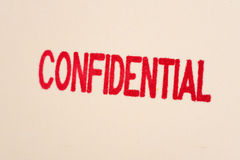 Red confidential stamp on a folder Stock Photos
