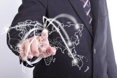 Red conmovedora del hombre de negocios en todo el mundo Fotografía de archivo