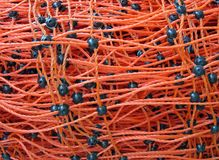 Red connected plastic cables heap, Stock Photography
