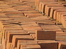 Red construction bricks background. Red construction bricks piled near a construction site Stock Photos