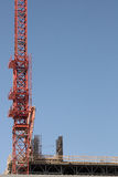 Red Construction Crane on building. Red Construction Crane on roof of building royalty free stock photo
