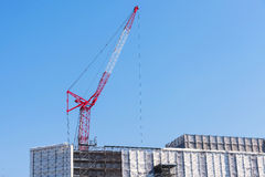 Red construction cranes in Japan Royalty Free Stock Photos