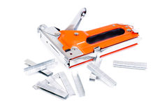 Red construction stapler and staples. Isolated ower white stock images