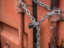 Red container cargo locked by chain Royalty Free Stock Image