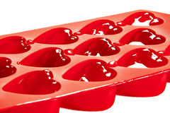 Red container for ice form of hearts Royalty Free Stock Images