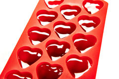 Red container for ice form of hearts Stock Image