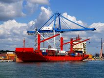 Red Container Ship 1. Red Container Ship alongside loading containers at container terminal Stock Photography
