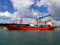 Red Container Ship 2. Red Container Ship alongside loading containers at container terminal Stock Image