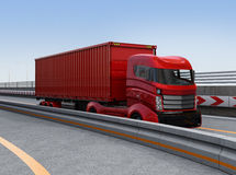 Red container truck on the highway Stock Photo