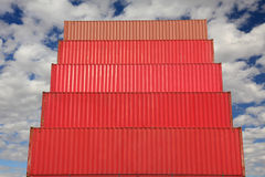 Red containers in logistics harbor. Red stacked containers waiting to be loaded in harbor Royalty Free Stock Photography