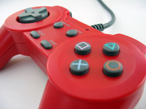 Red controller. A red video game controller isolated over white Royalty Free Stock Images