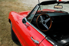 Red Convertible 2. Red Alfa Romeo convertible car / automobile quater angle view of steering wheel royalty free stock image