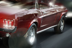 Red Convertible. Stylized shot of a red shiny sports car in movement Stock Image
