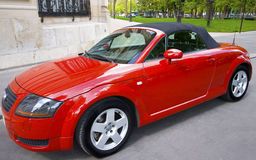 Red cabriolet. A red convertible car in the streets of paris with white rims Royalty Free Stock Photo