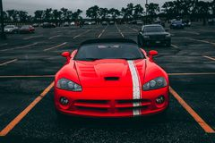 Red Convertible Coupe on Black Surface Royalty Free Stock Photos