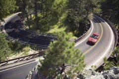 Red convertible driving on Iron Mountain. Road, Black Hills, near Mount Rushmore National Memorial, South Dakota Stock Image