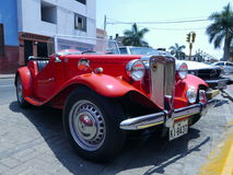 Red convertible MG TA Roadster Midget in Lima Royalty Free Stock Image
