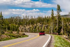 Red convertible sport car on highway Royalty Free Stock Photography