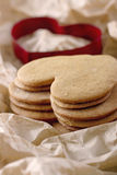 Red cookie cutter and a pile of gingerbread cookies Stock Photography