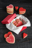 Red cookies with red icing and box Royalty Free Stock Photo