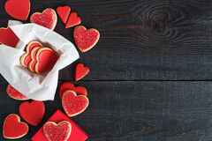Red cookies with red icing and box Royalty Free Stock Images